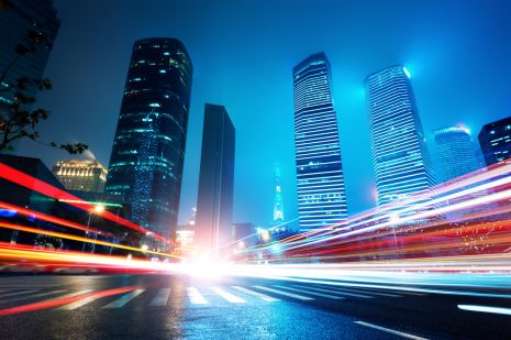 high tech buildings in the city with colorful abstract lighting